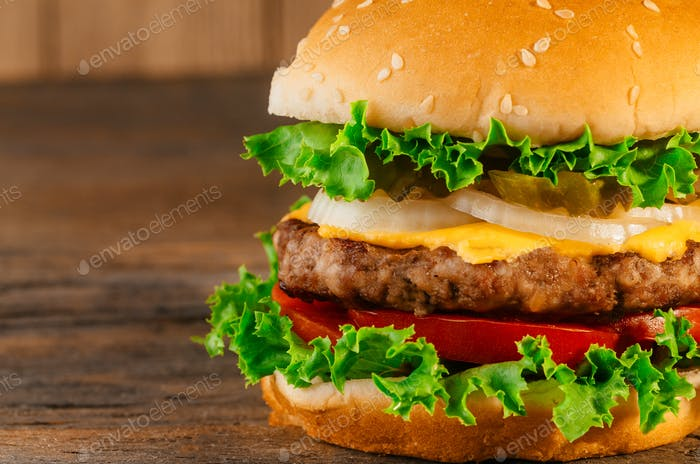 Homemade hamburger with fresh vegetables Classic deluxe cheeseburger
