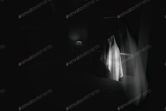 black and white ghost women in haunted hotel with double exposure and dark filter (halloween concept