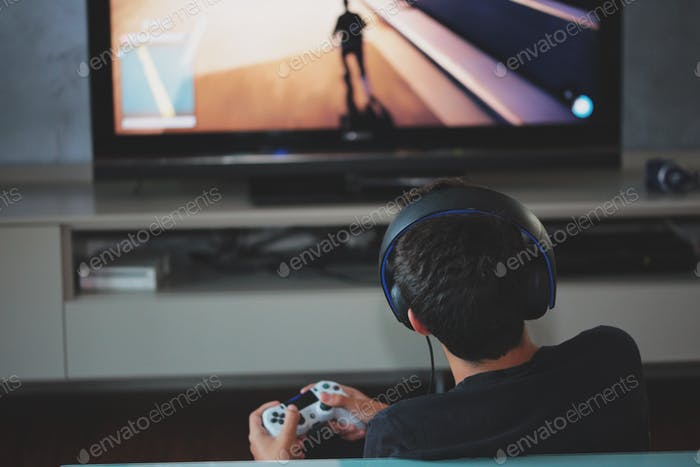 A boy plays video games