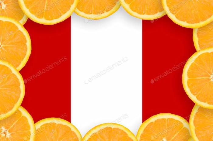 Peru flag  in frame of orange citrus fruit slices