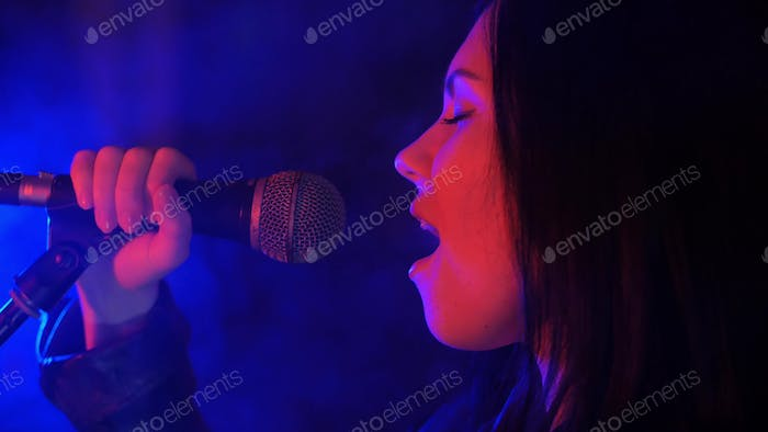 Emotional woman singing a song