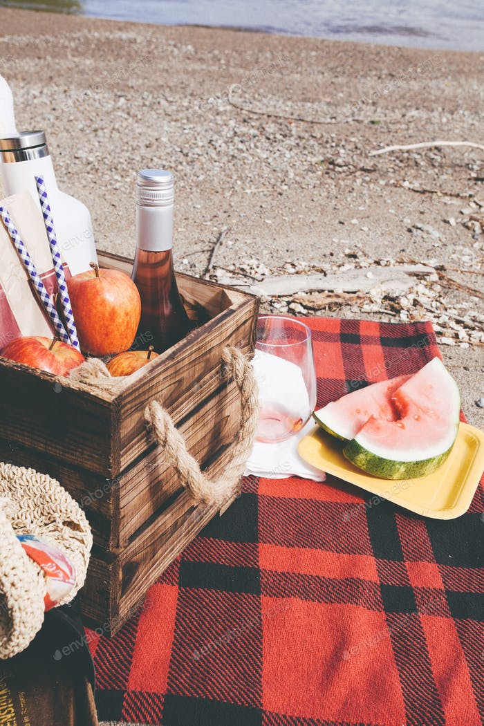 Picnic blanket with watermelon and rosé