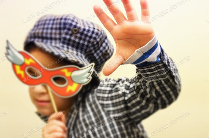 girl Tomboy with Superhero mask high five
