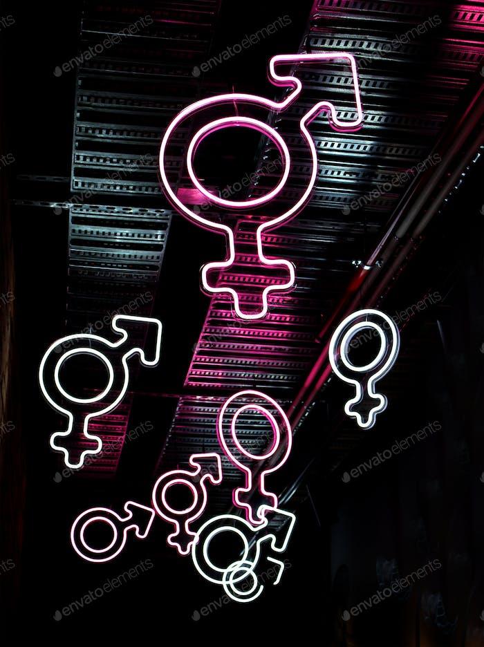 Neon gender symbols - a combination of Mars (male) and Venus (female)