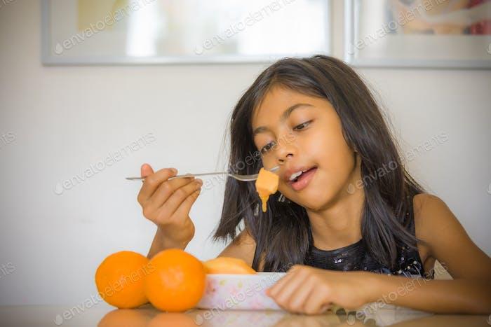 Little girl enjoying summer fruits