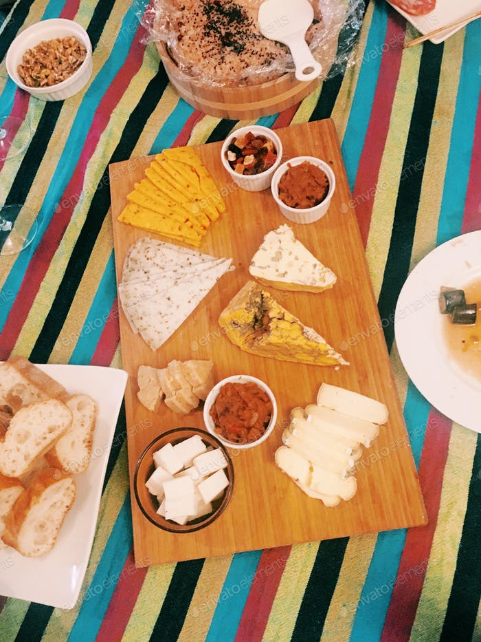 Cheeseboard on striped tablecloth.