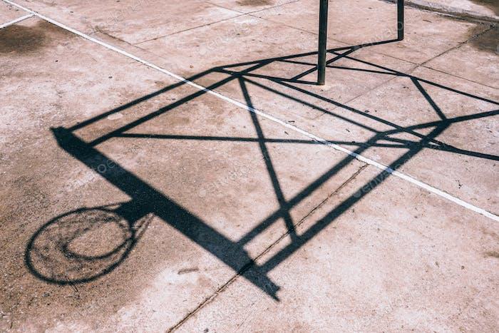 Abstract shadows of a basketball hoop.