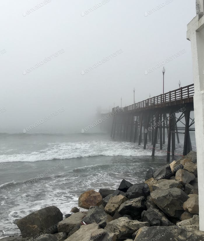 Wooden pier disappearing into fog