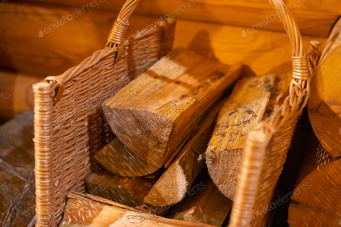 Basket with firewood on wooden background, russian bathhouse