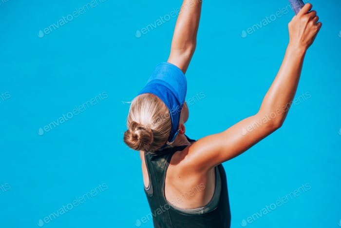playing tennis, young athlete, 12 years old, competitive sport, minimal portrait on blue background