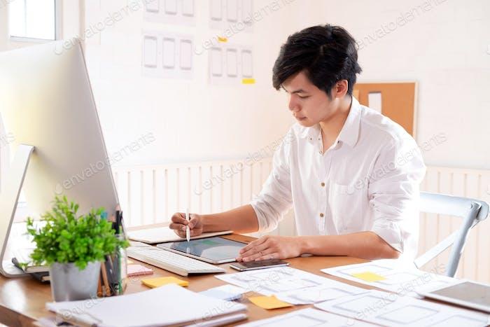 Software developer and UX UI designer are designing mobile application.