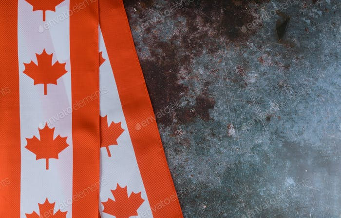 Canada Day celebration and national holidays Canadian red and white flag against dark rustic