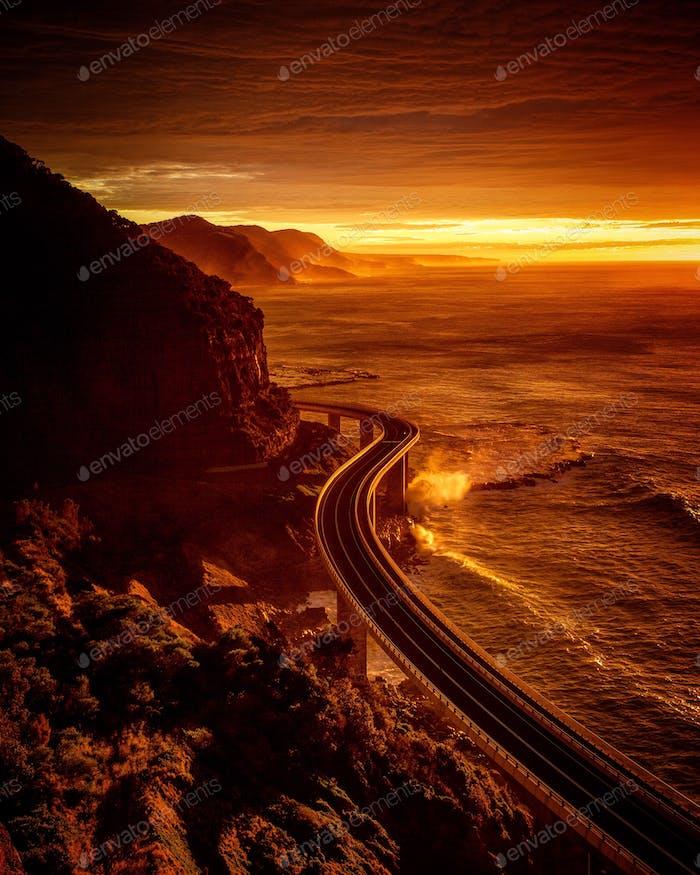 Sea cliff bridge in a sunrise glow, coal cliff, Australia