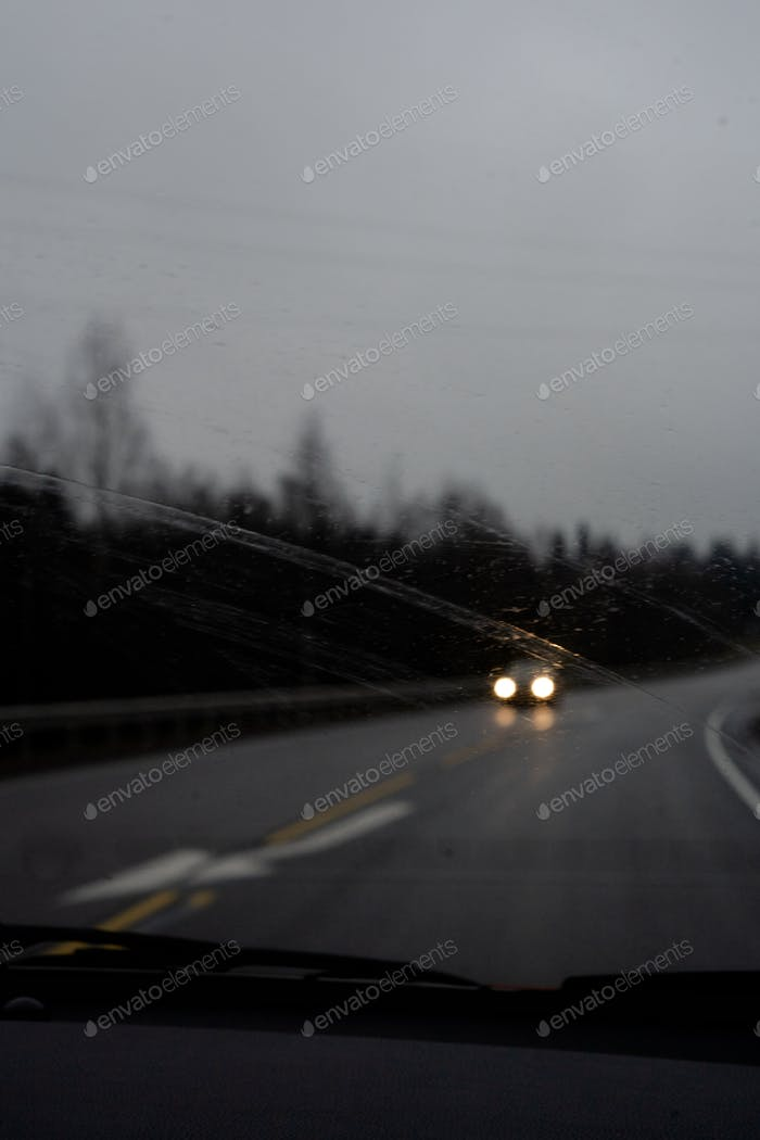 Moody trip, driving car on a road in a moody weather