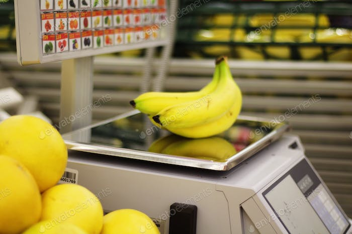 Fresh bananas on scales in a supermarket