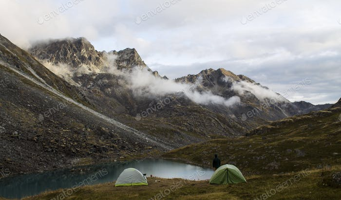 Camping at an alpine lake in Alaska. Rugged, beautiful Alaskan landscape.