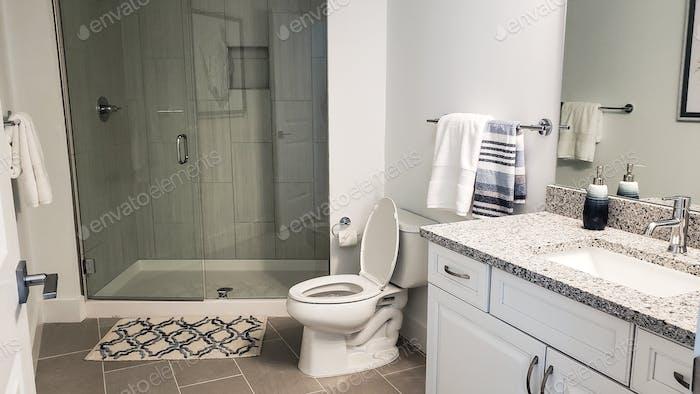 A modern bathroom in a newly furnished beach condo ready for use...