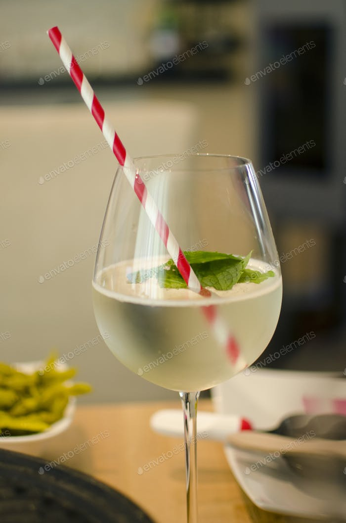 Mixed drink: prosecco, lime, and mint