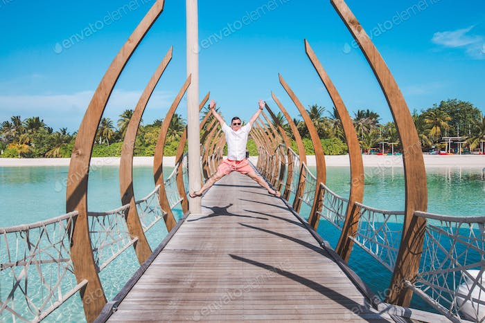 Man jumping of excitement on a vacation trip to the Maldives
