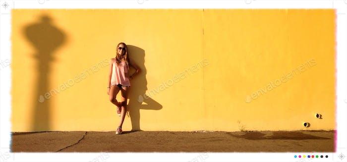 Girl on Yellow Wall