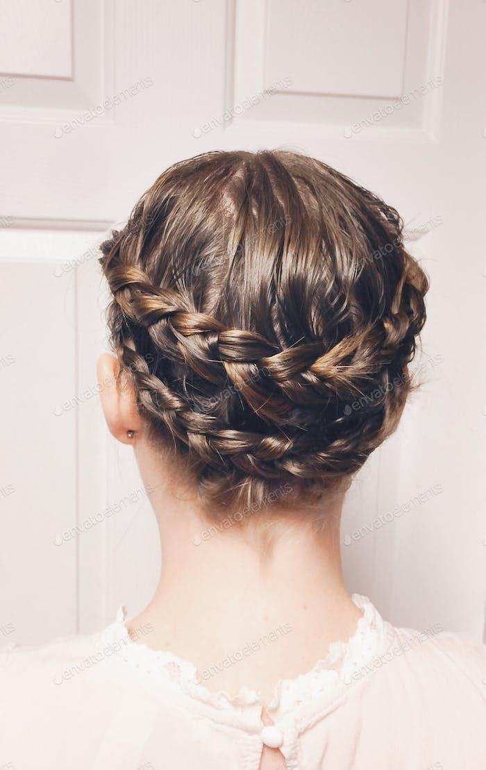 Hair braids in a crown on head