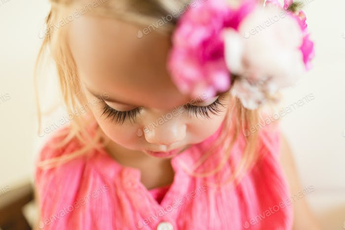 Little girl with long eyelashes and a flower crown