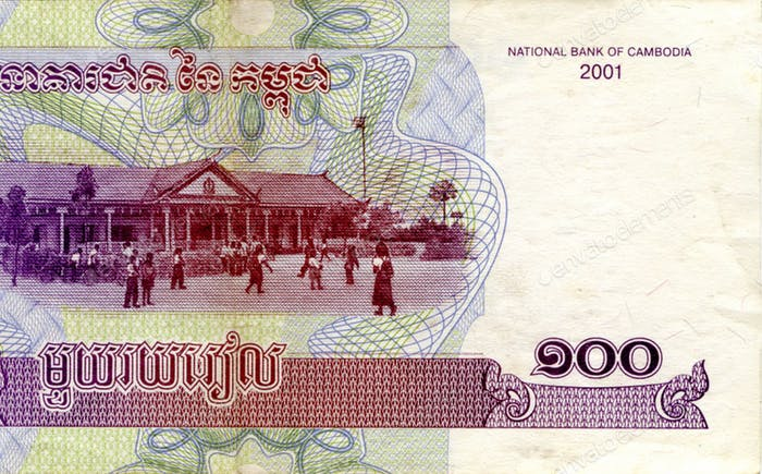 Fragment of 100 Cambodian riels banknote is national currency of Cambodia