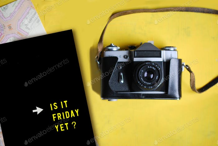 Vintage camera  with peg board with message 'Is it Friday Yet?