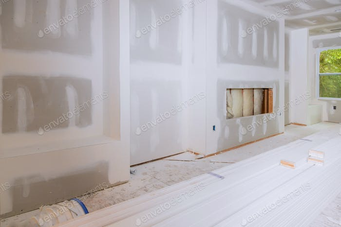 House hall interior with drywall completely installed and painted wall