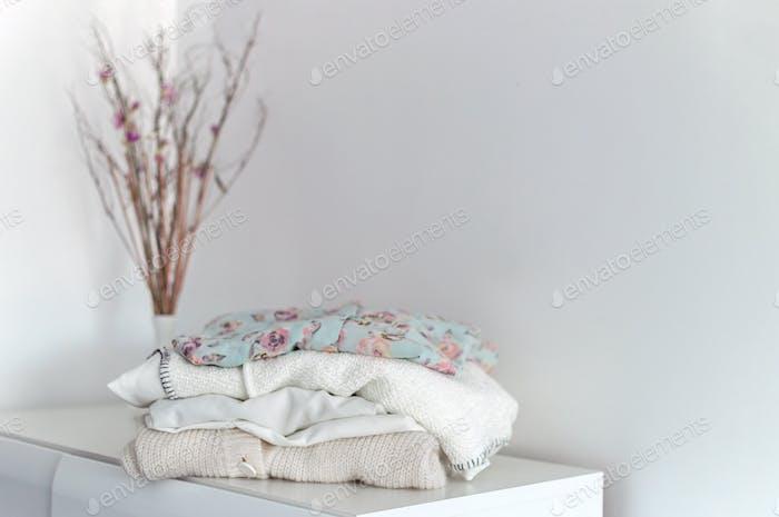 Minimalist lifestyle. Capsule wardrobe neatly organizes on white background. Place for text