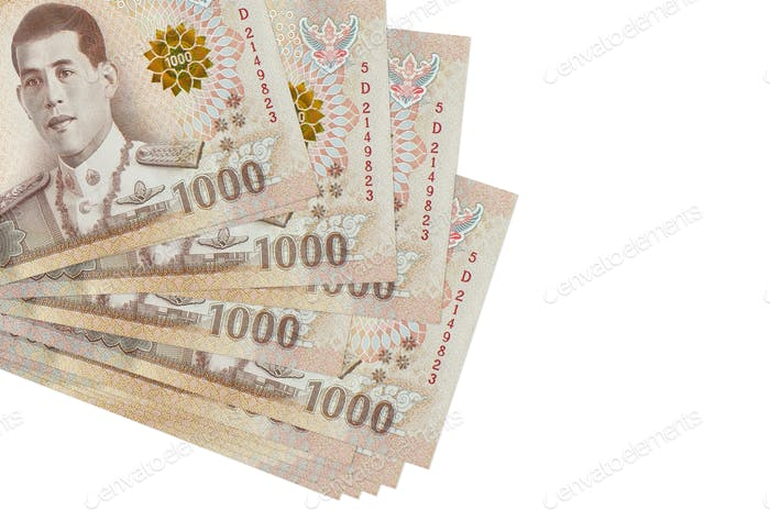 1000 Thai baht bills lies in small bunch or pack isolated on white. Mockup with copy space. Busines
