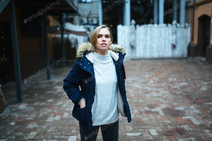 Hipster girl wearing dark blue jacket