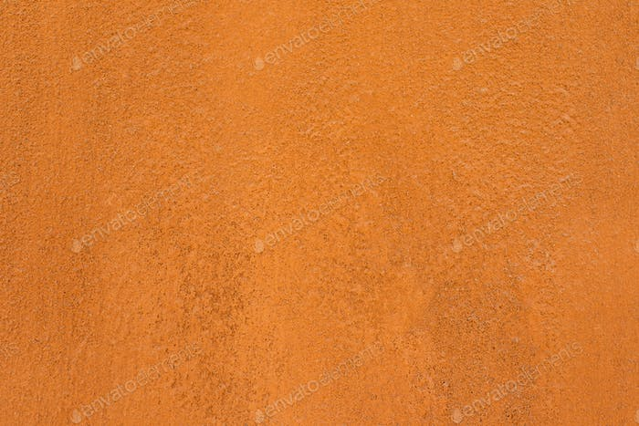 Traditional moroccan terracotta colored background. Orange or ocher clay wall texture. Painted
