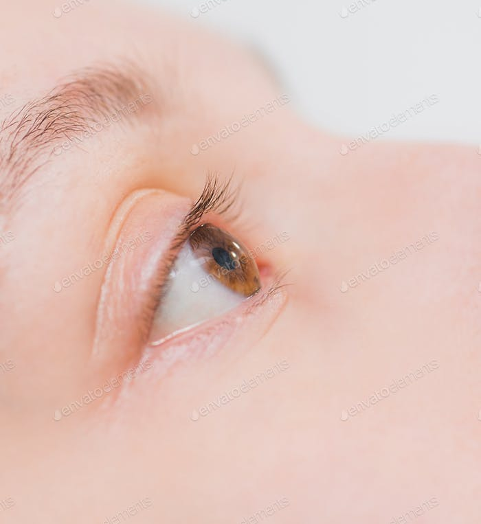 Close up of woman instilling eye drops, ophthalmology, optometry graphic