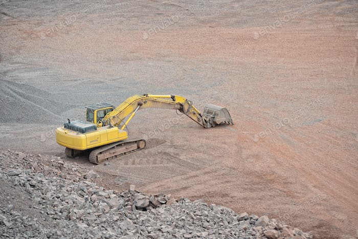 earth mover in a Porphyry rock quarry. mining industry. quarry