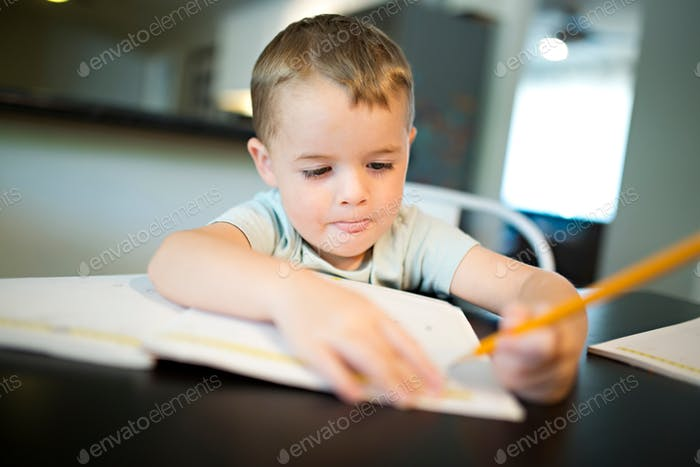 Boy writing a letter or writing a letter to a friend
