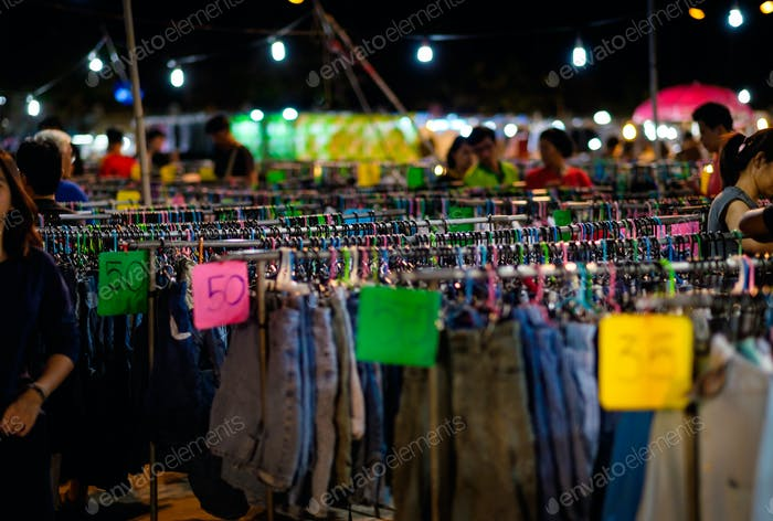 The second hand clothes hanging in the street market