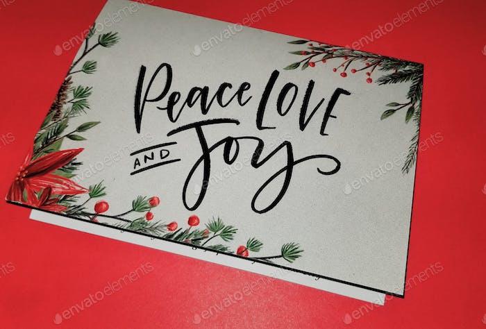 Frieden, Liebe und Freude! Frohe Feiertage! Frohes neues Jahr! Jahreszeiten Grüße!