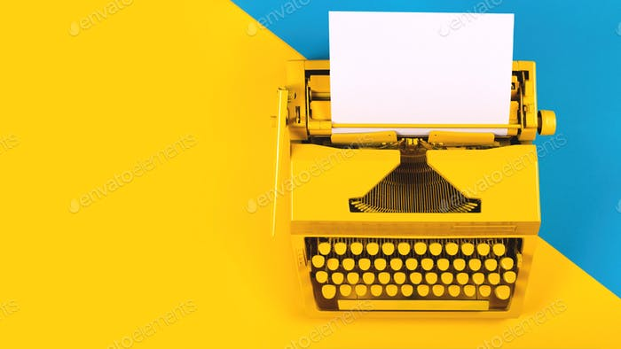 Yellow bright typewriter on a yellow and blue background