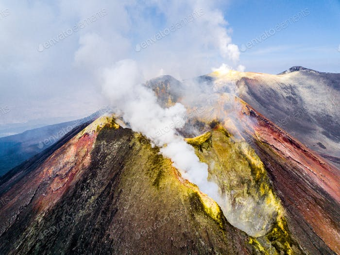 Colorful mineral deposits adorn Mt. Etna during an active eruption in August 2017