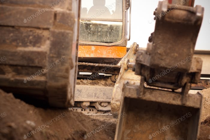 Close up of a track hoe used in heavy construction for excavation.