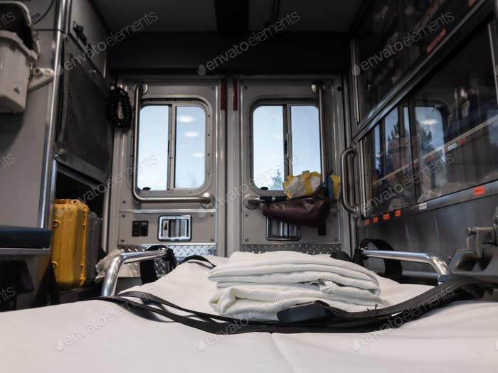 Interior of Ambulance Looking Out Back Windows from Patient Perspective with Focus on Foreground