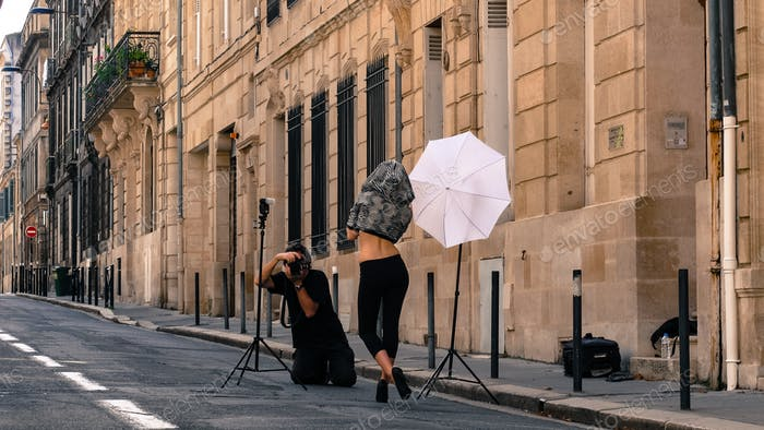 A model vs a photographer,- in the streets of Bordeaux old city, France.
