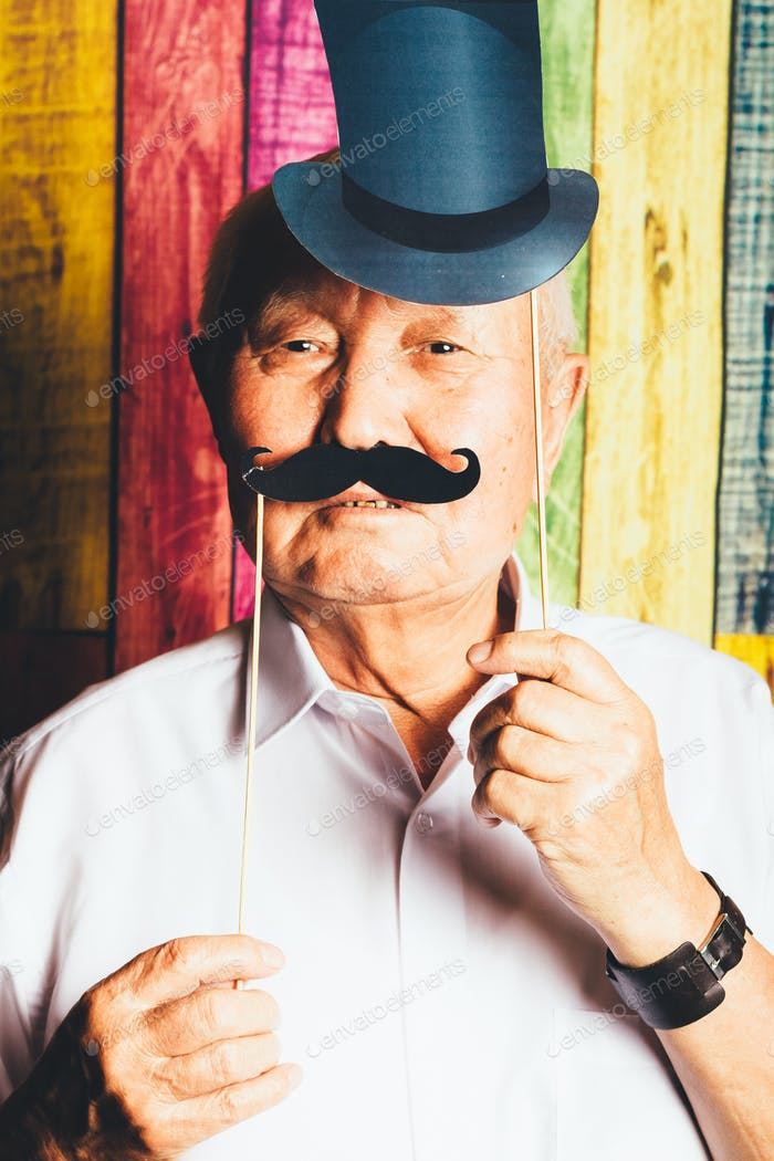 grandpa with a photo booth props
