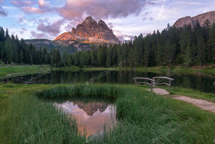 Evening reflections at lake Antorno in Dolomites mountains, Italy.