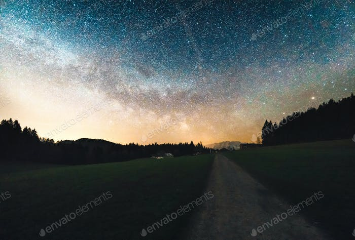 A beautiful apline landscape shot with the milky way in the background.