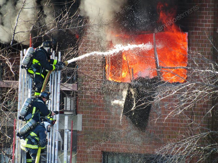 Boston firefighters extinguishing a fire