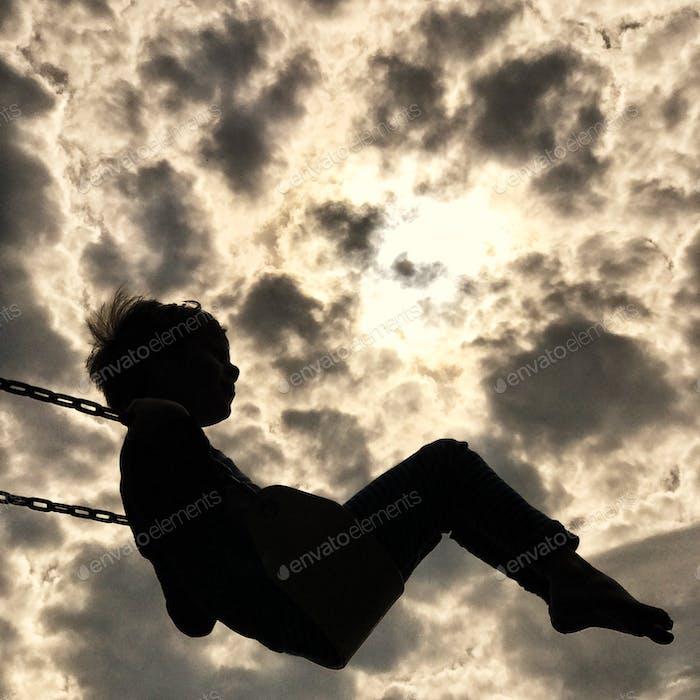 Swinging.