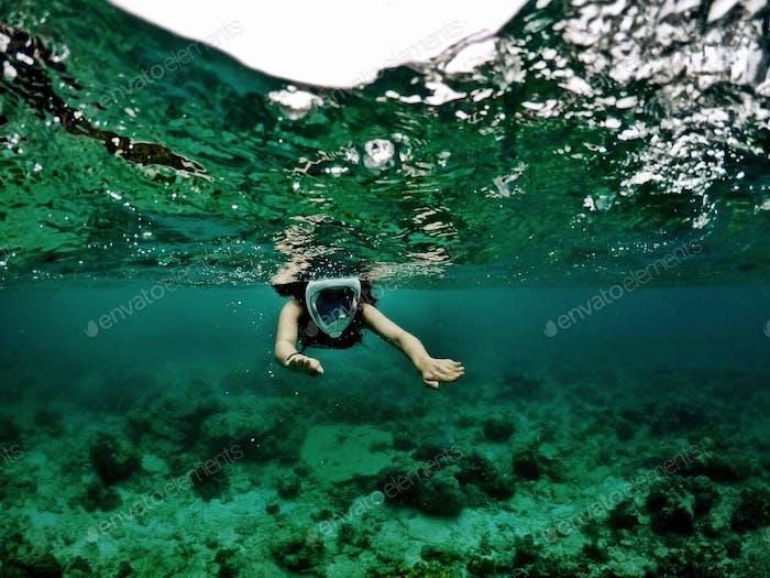 Snorkeling in the crystal clear waters of El Nido, Palawan, Philippines.