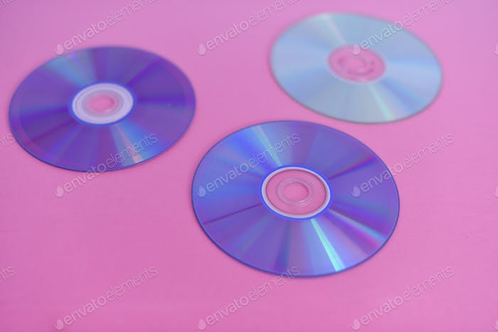 Compact disc isolated against pink background